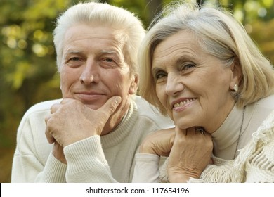 beautiful elderly couple smiling in the autumn park