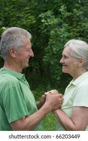 beautiful elderly couple in a summer park