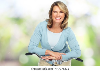 Beautiful elderly woman with bicycle.