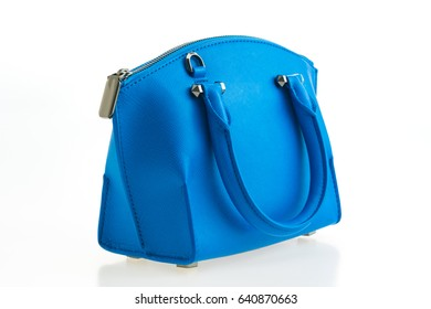 Beautiful elegance and luxury fashion women and blue leather handbag isolated on white background