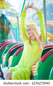 beautiful elegant blonde fashion woman in amusement park summer day