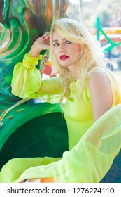 beautiful elegant blonde fashion woman portrait in amusement park summer day