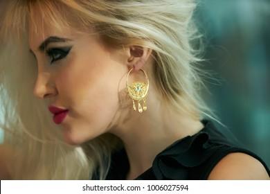 Beautiful elegant blonde woman posing in black dress