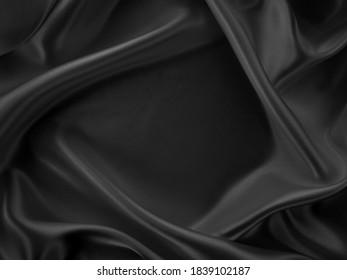 Beautiful elegant dark silver grey or black satin silk luxury cloth fabric texture, abstract background design.