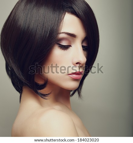 Beautiful elegant female with black short hair. Closeup art portrait