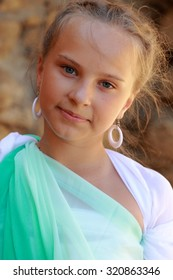Beautiful elegant girl a Greek-style antique  dreams/Young girl in a role of the Greek goddess of outdoors