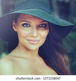 Beautiful elegant lady in black hat