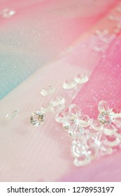 A beautiful and elegant macro of glitter from sparkling diamonds with bokeh or depth of field and pink texture as background