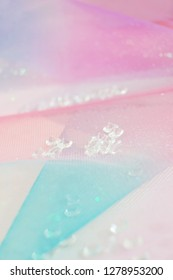 A beautiful and elegant macro of glitter from sparkling diamonds with bokeh or depth of field, space and pink texture as background