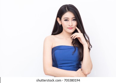 Beautiful and elegant Model of Asian woman wearing blue long evening dress put her finger touching her cheek like thinking something isolated on white background