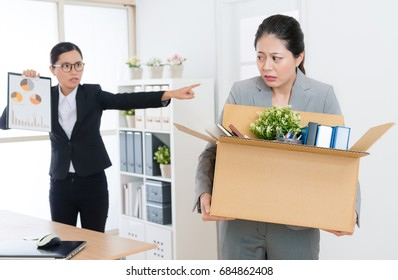 beautiful elegant office worker girl feeling fear when angry pretty business boss woman showing company marketing report to blame and fired her.