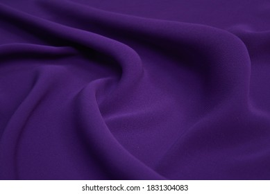 Beautiful elegant wavy violet purple satin silk luxury cloth fabric texture with violet background design.