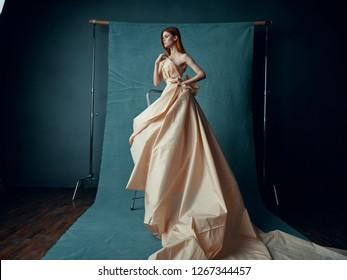 Beautiful elegant woman in carnival dress on photo shoot