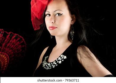 Beautiful elegant woman with fan in black evening dress