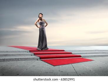Beautiful elegant woman on a red carpet
