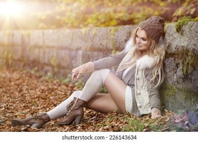 Beautiful elegant woman  in a park in autumn