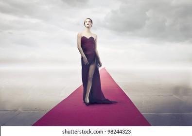 Beautiful elegant woman walking on the red carpet