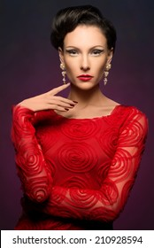 Beautiful elegant woman wearing red dress and lovely makeup