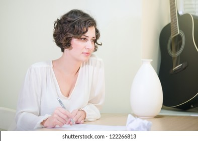 Beautiful elegant woman writing