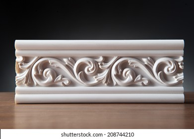 Beautiful elements of luxury wall design, white stucco mouldings over dark background, antique plastering