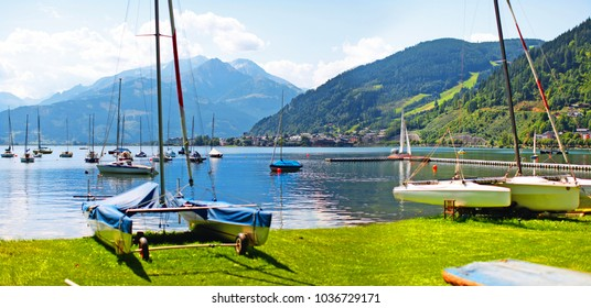 beautiful embankment port with yachts and boats standing in the lake at the resort of Zell am See in Austria