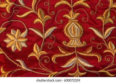 Beautiful embroidery flower design gold in a purple garments.