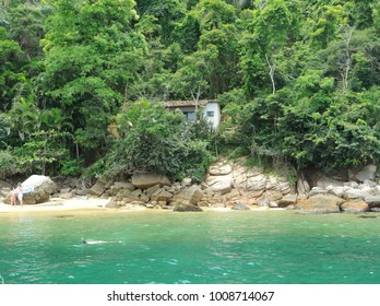 Beautiful emerald green sea bay, can be well used in one of the boat or schooner tours. There is also the view of part of the city of Paraty.