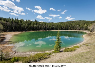 Beautiful emerald and turquoise colors of Kootenay Pond in Kootenay National Park in British Columbia, Canada