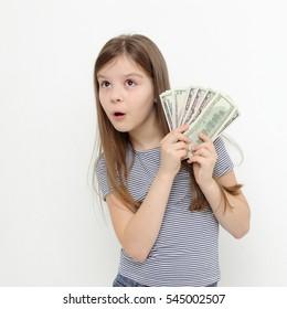Beautiful emotional teen girl holding USA dollars