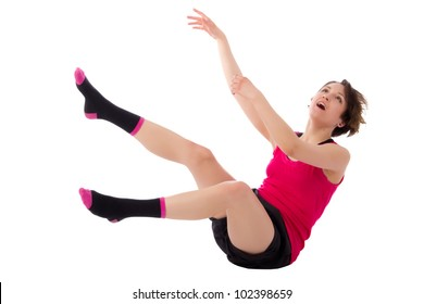 A beautiful emotional young woman falling over white background