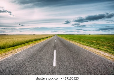 Beautiful Empty Asphalt Freeway, Motorway, Highway Country Road In Countryside. Travel Road Concept. Cloudy Sky. Nobody