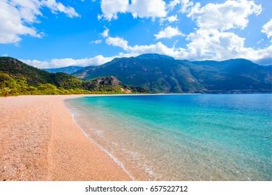 Beautiful empty beach with turquoise water in oludeniz - Fethiye, Turkey