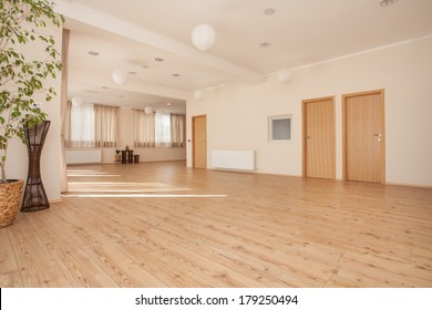 Beautiful, empty naturally lit yoga studio.
