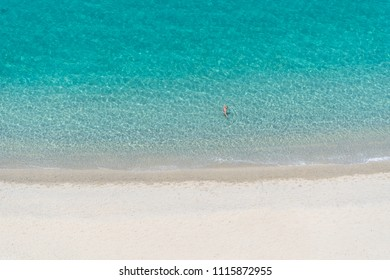 Beautiful empty sandy beach and turquoise sea from above