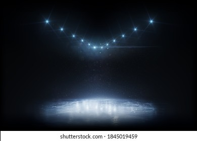 Beautiful empty winter background and empty ice rink with lights. Winter background. Spotlight shines on the rink. Bright lighting with spotlights