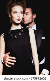 Beautiful enamored passionate couple standing in the aisle, a man hugging a woman from behind