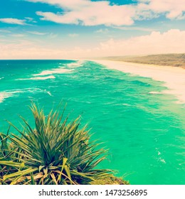 Beautiful endless Australian beach on Stradbroke Island, Queensland with retro style filter effect