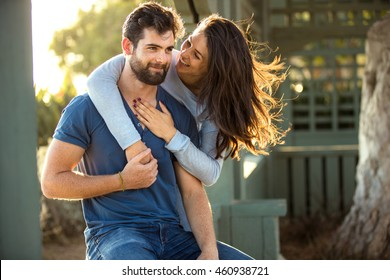 Beautiful engaged couple fiance hug and kiss good mood outside