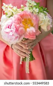 Beautiful engagement flowers bouquet focus on hands