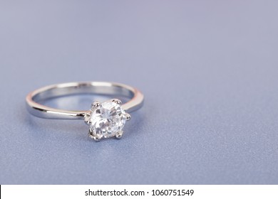 Beautiful engagement ring with a big stone on a gray background