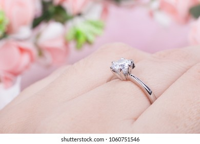 Beautiful engagement ring with a large stone on a woman's hand