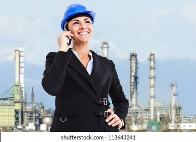 Beautiful engineer talking on the phone