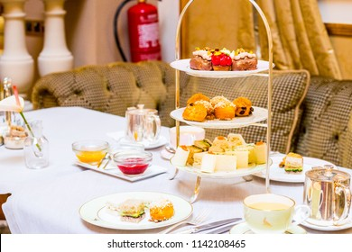 Beautiful English Afternoon Breakfast Tea Ceremony with Desserts and Snacks in Barcelona Luxury Hotel