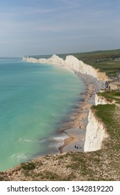 Beautiful English coast Birling gap beach and Seven Sisters white chalk cliffs East Sussex England with turquoise sea