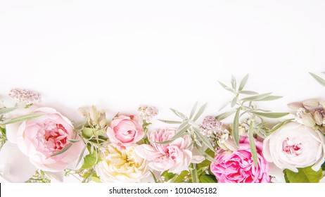 Beautiful English rose flower bouquet composition on white background. Greeting card, invitation in light pastel colors. Copy space. Mother's, Valentines, Women's Wedding Day concept.
