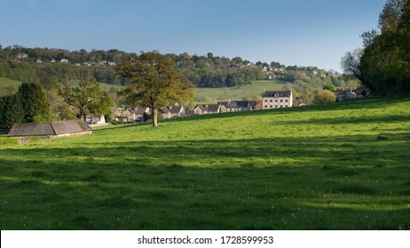 A BEAUTIFUL  ENGLISH VILLAGE SITUATED ON A HILL AMONG GREEN MEADOWS