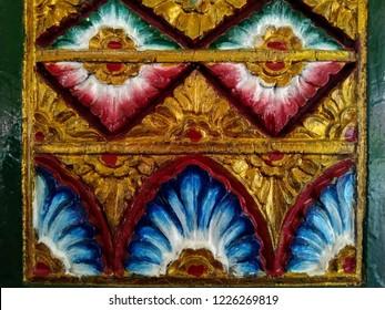 a beautiful engraving on wood pillar (soko) of a traditional javanese building (joglo) in prince mangkubumi palace (dalem) of yogyakarta