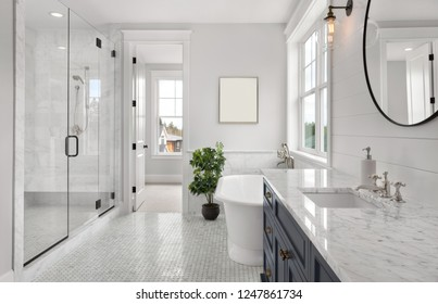 Beautiful Ensuite Master Bathroom in New Luxury Home. Features Elegant Countertop, Bathtub, Shower, and Walk-in Closet