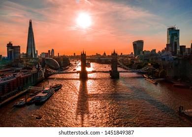 Beautiful epic sunset over Tower Bridge in London, UK. Moment when Tower Bridge lifting gates. The symbol of London.