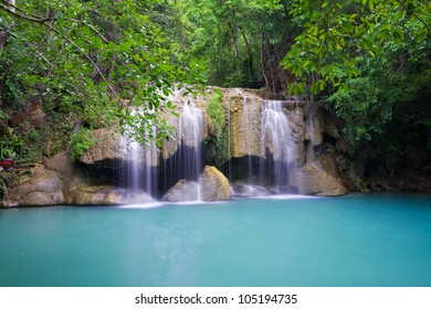 Beautiful Erawan Waterfall with long exposure in rain forest - Thailand